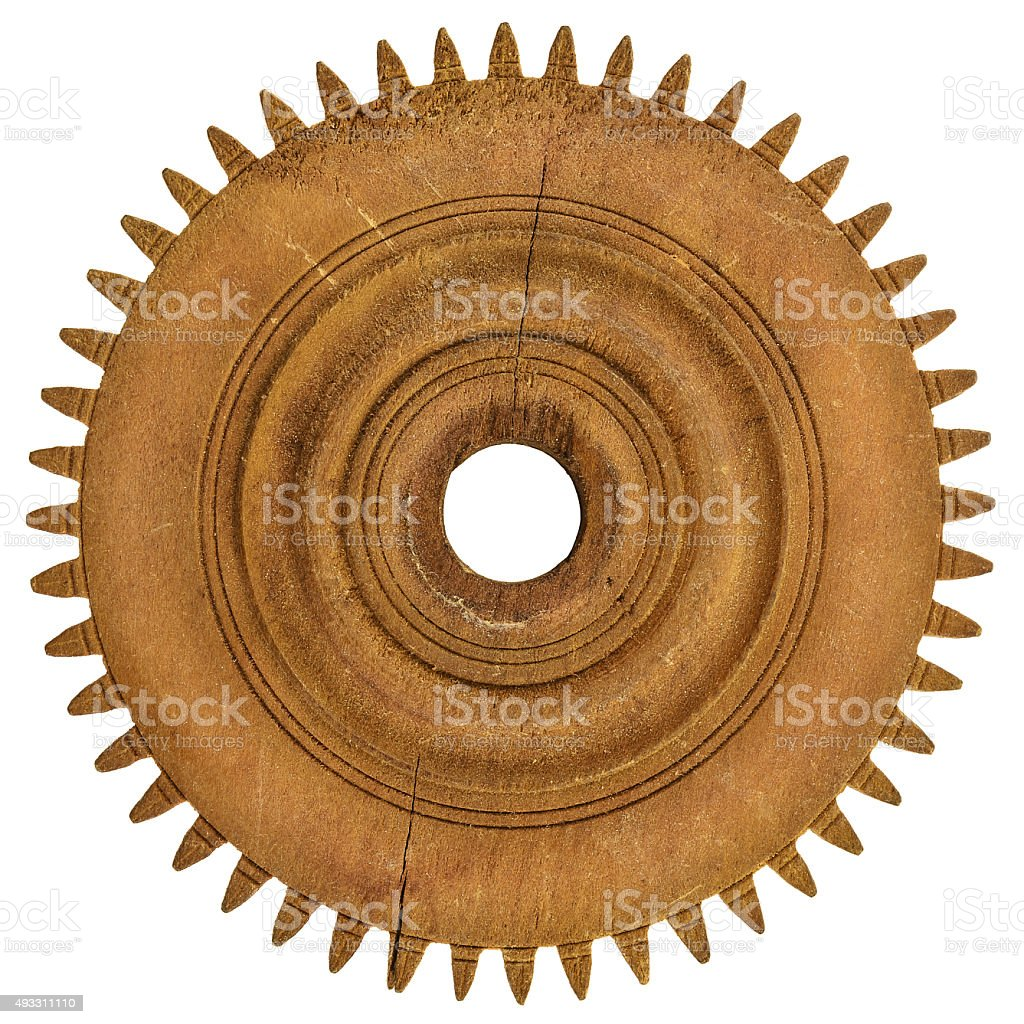 Old wooden gear wheel isolated on white stock photo