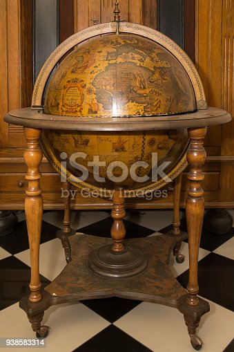 636605172istockphoto Old wooden globus 938583314