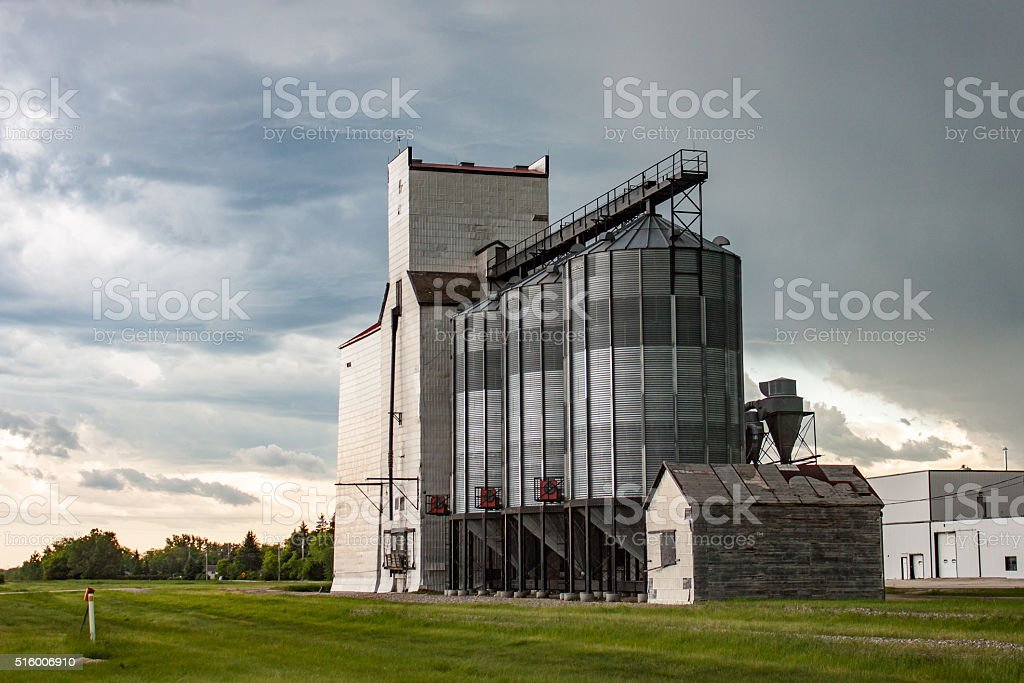 Old Wooden Grain Elevator Against Dramatic Sky stock photo