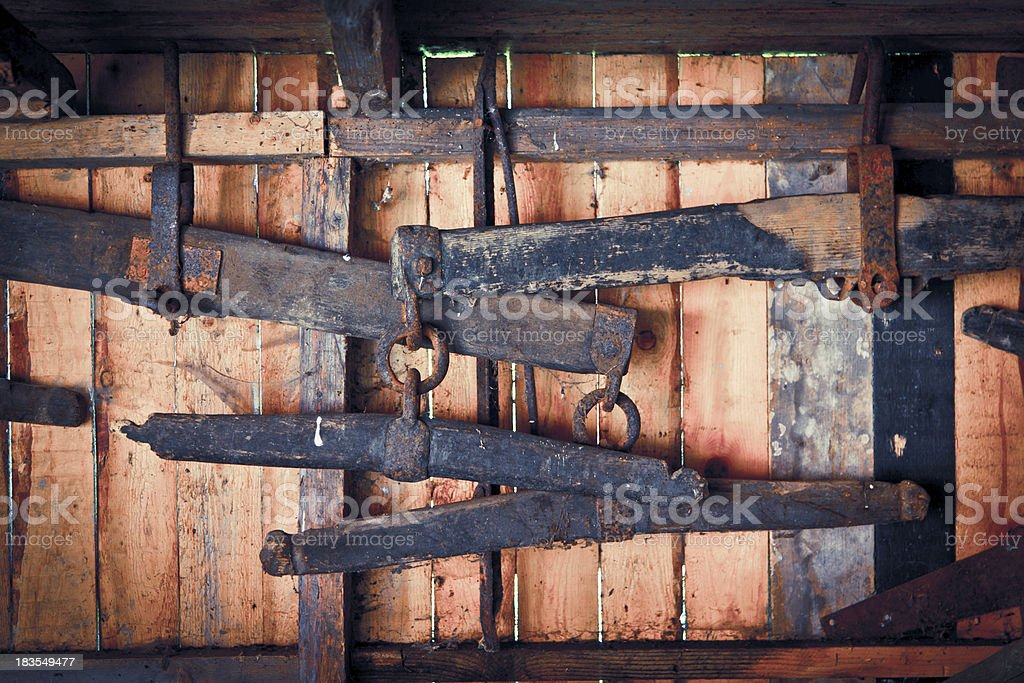 Old wooden horse equipment on wall stock photo