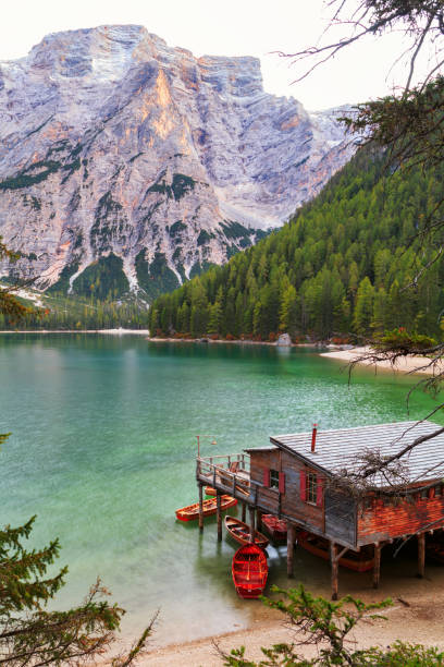 Old wooden house on the Braies lake in the background of Seekofel mountain Old wooden house on the Braies lake in the background of Seekofel mountain in Dolomites,Italy ( Pragser Wildsee ) trentino alto adige stock pictures, royalty-free photos & images