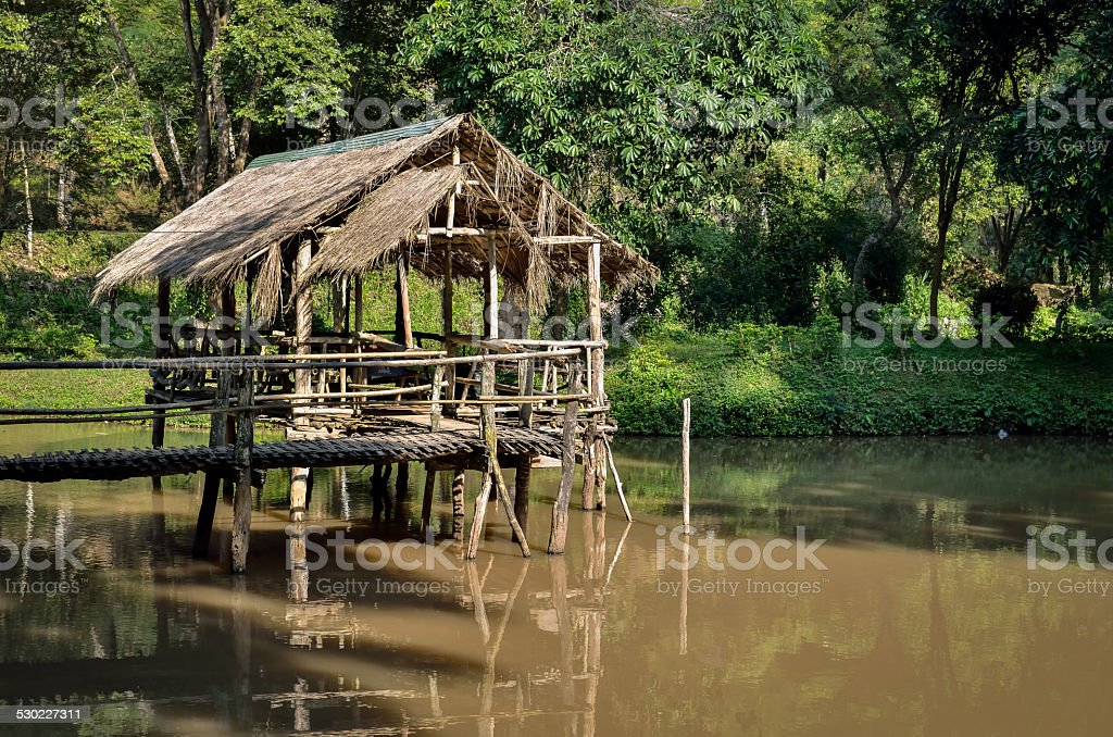 Old wooden house on the river stock photo