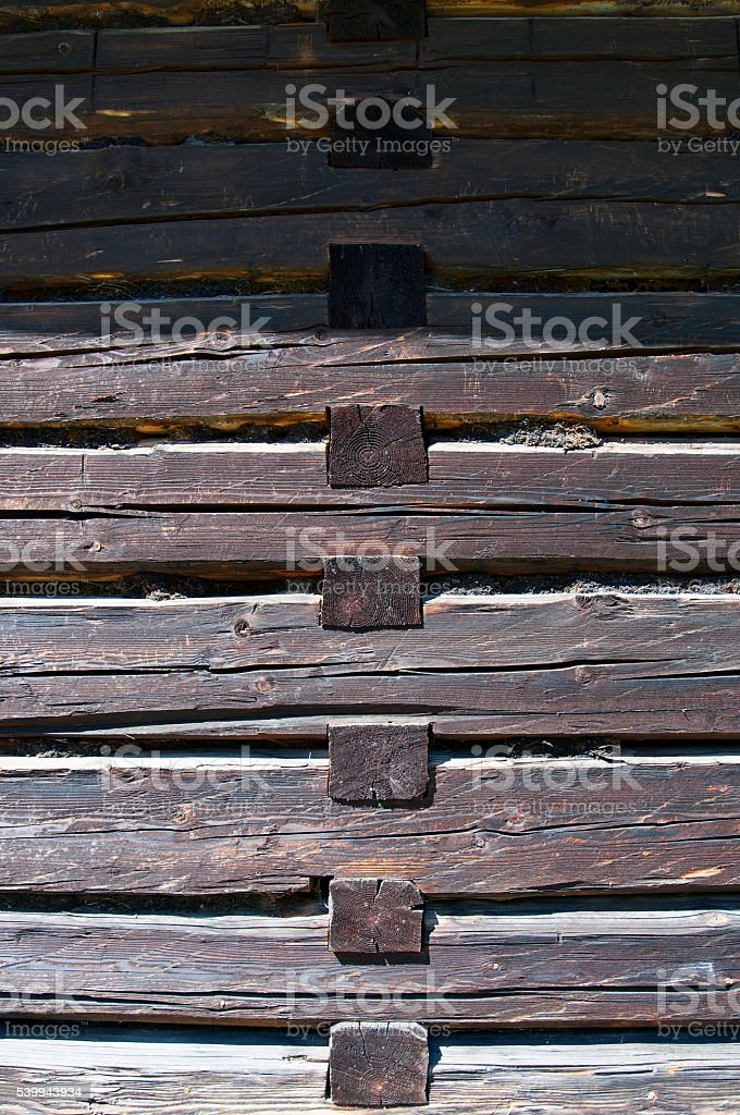 Old wooden house wall beam connection stock photo