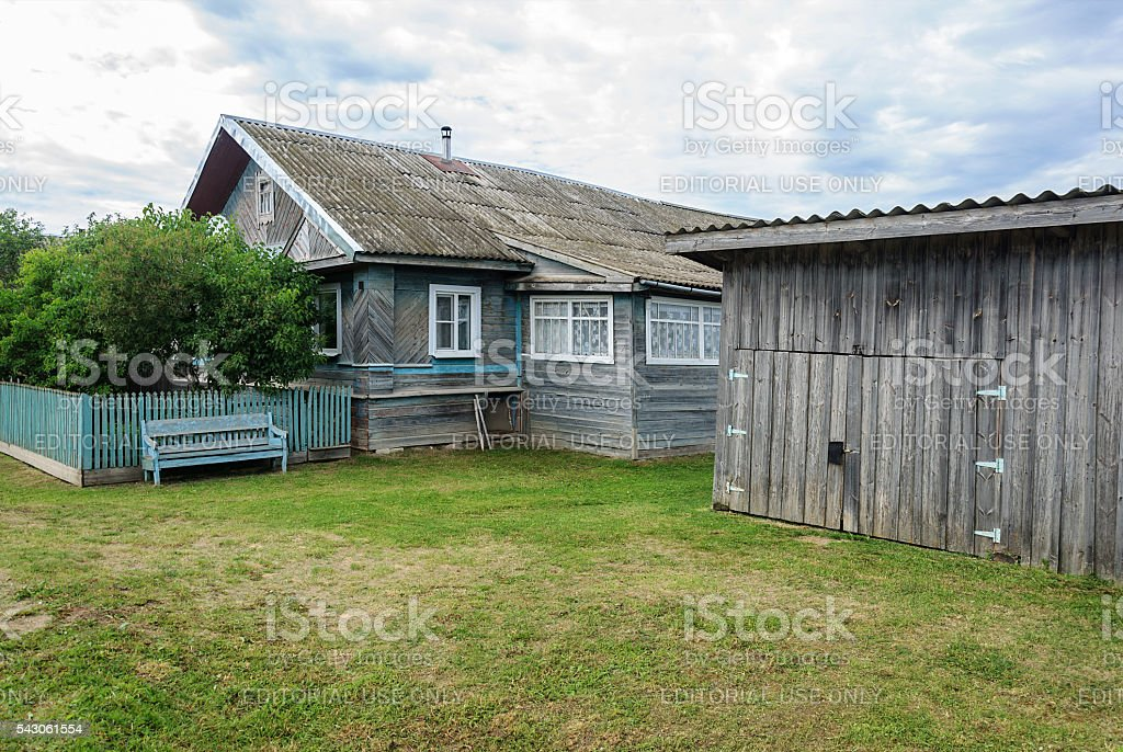 Old wooden house with shed in the village stock photo