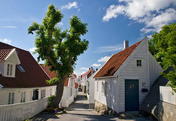 Old wooden houses in the city of Skudeneshavn, Norway. stock photo