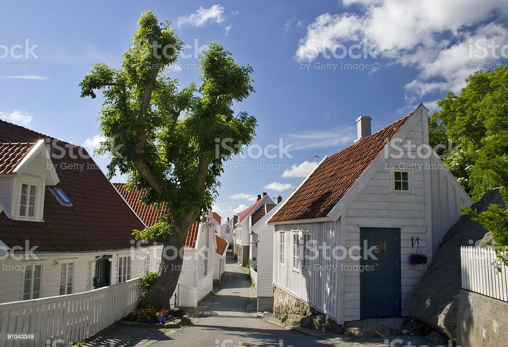 Old wooden houses in the city of Skudeneshavn, Norway. stock photo