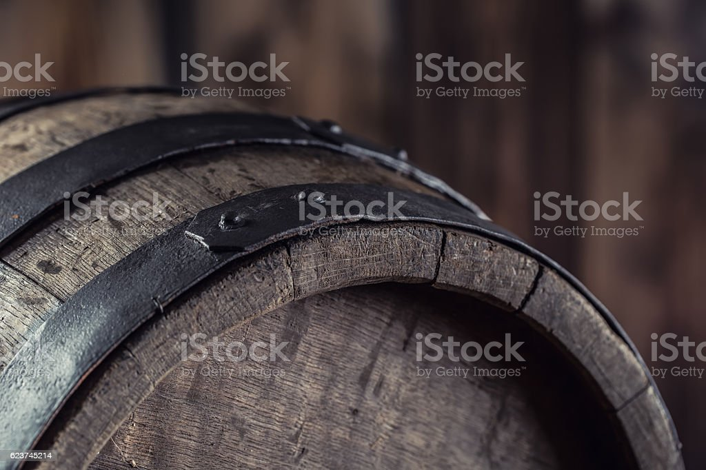 Old wooden keg. Barrel on beer vine whiskey brandy cognac. stock photo