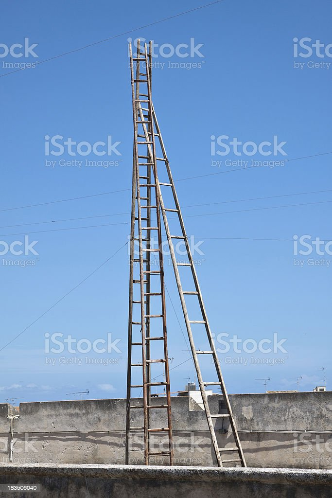 Old wooden ladders on the deep blue background royalty-free stock photo
