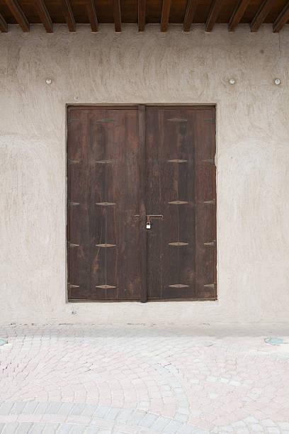 old wooden locked door stock photo