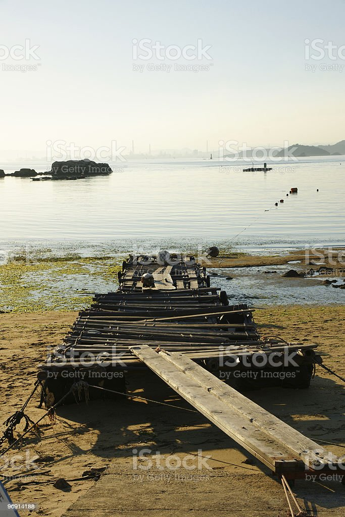 Old wooden made dock on the beach royalty-free stock photo