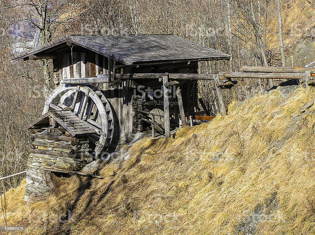 Old wooden mill stock photo