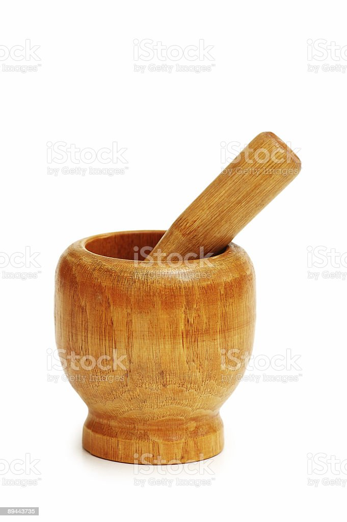Old wooden mortar and pestle isolated on white royalty-free stock photo