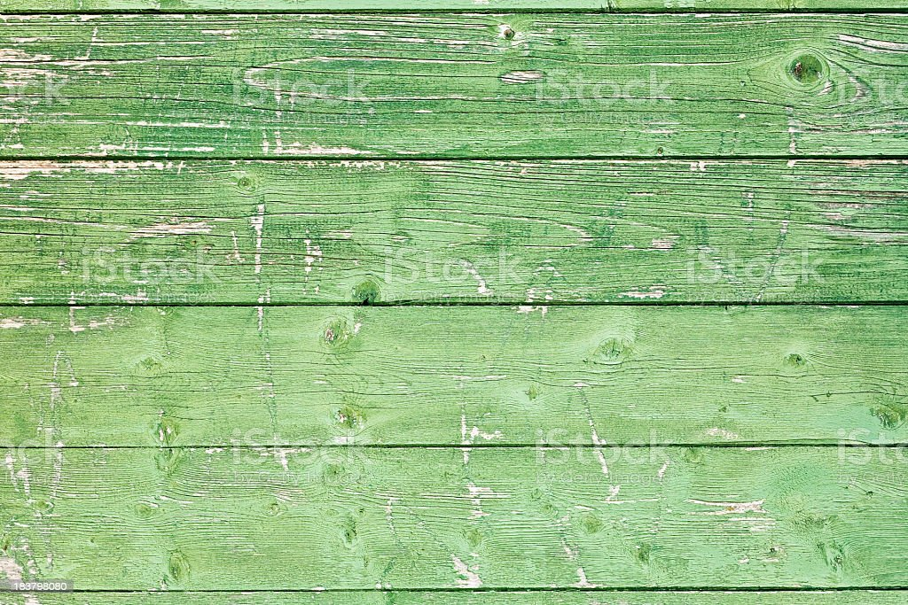 Old wooden panels with uneven green paint stock photo