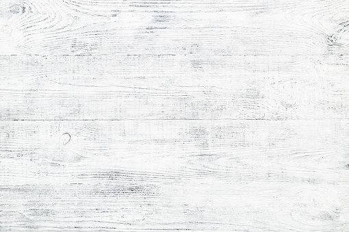 Old wooden plank texture. Shabby chic faded wood background with cracks and scratches. White & gray painted vintage board.