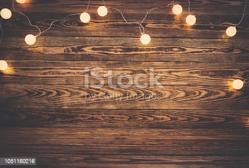 istock Old wooden planks with christmas decoration 1051160216