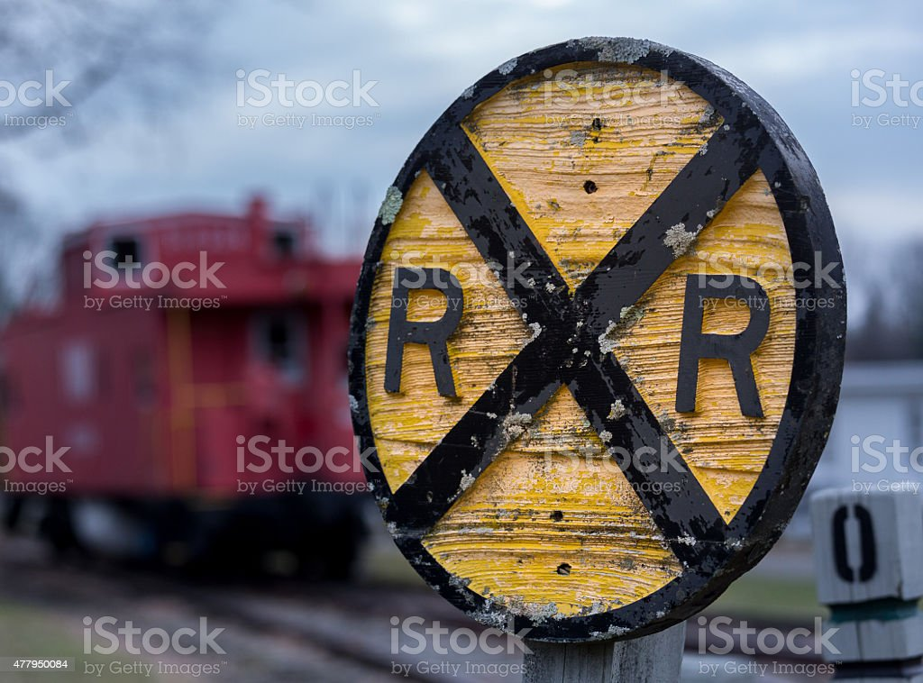 Old wooden railroad RR sign with caboose stock photo