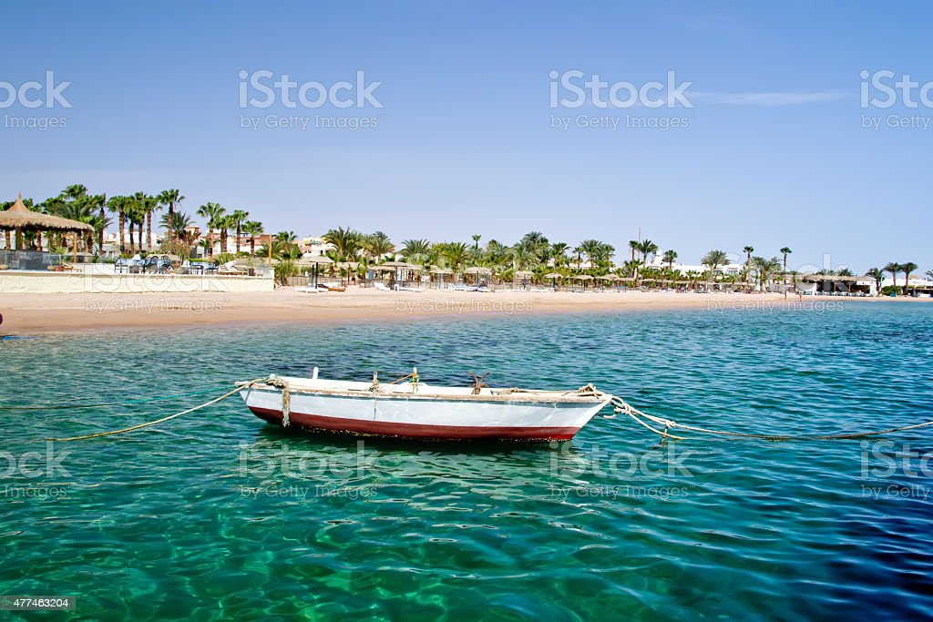 old wooden rowboat on sea stock photo