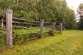 istock Old wooden rural corral fence in meadow 1030807498