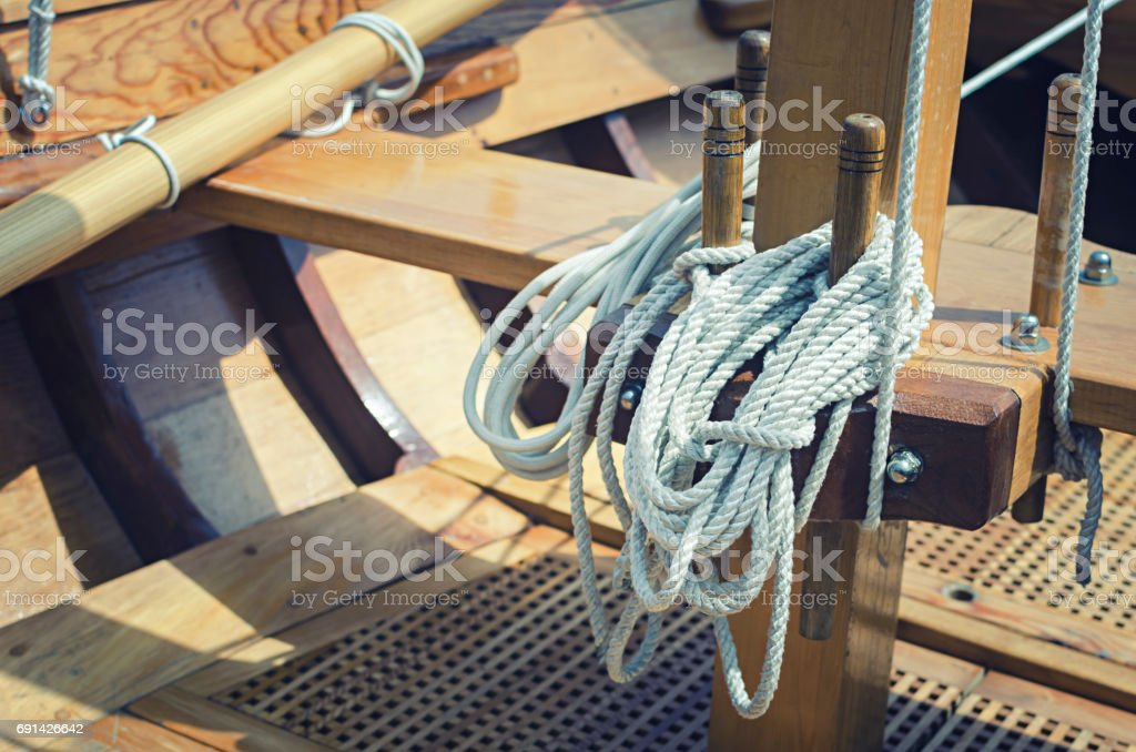 Old wooden sailboat ropes detail stock photo