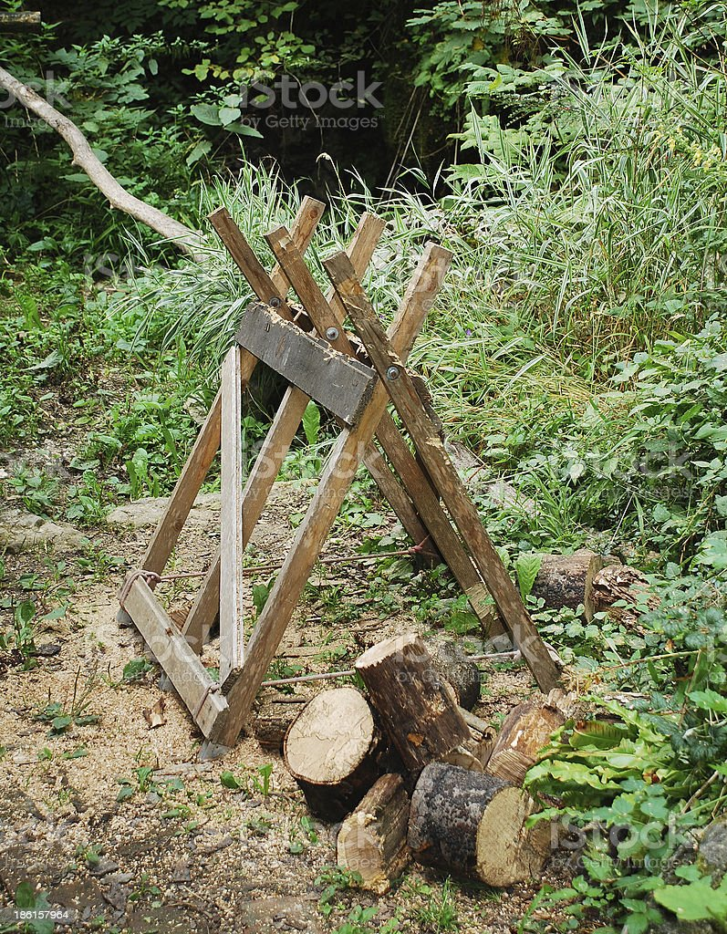 Old Wooden Sawhorse in Forest royalty-free stock photo