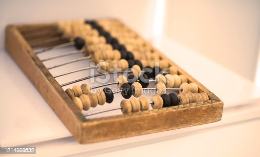istock Old wooden scores. close-up abacus . Abacus on light and brown background. Concept of savings, counting. Accounting and Budget Concept 1214669532
