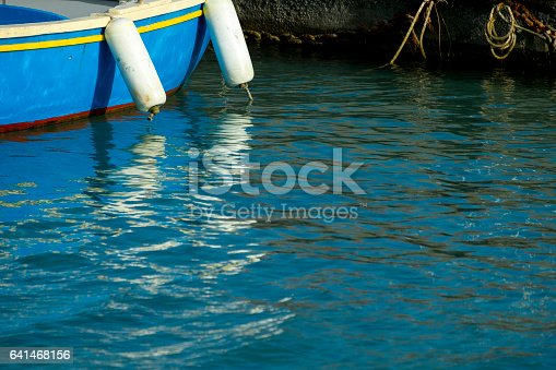 istock Old wooden shabby fishing boat 641468156