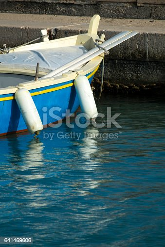 istock Old wooden shabby fishing boat 641469606