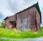 istock old wooden shed about to fall sideways. in Poland 1174116771