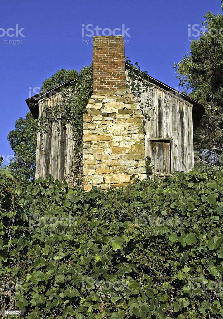 Old Wooden Shed and Rock Chimney royalty-free stock photo