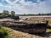 istock Old wooden ship, boat. Wreck in river, Torridge estuary, near Bideford, Devon, UK. 1253623443