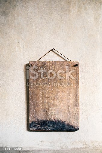 istock Old wooden signboard. 1144113655