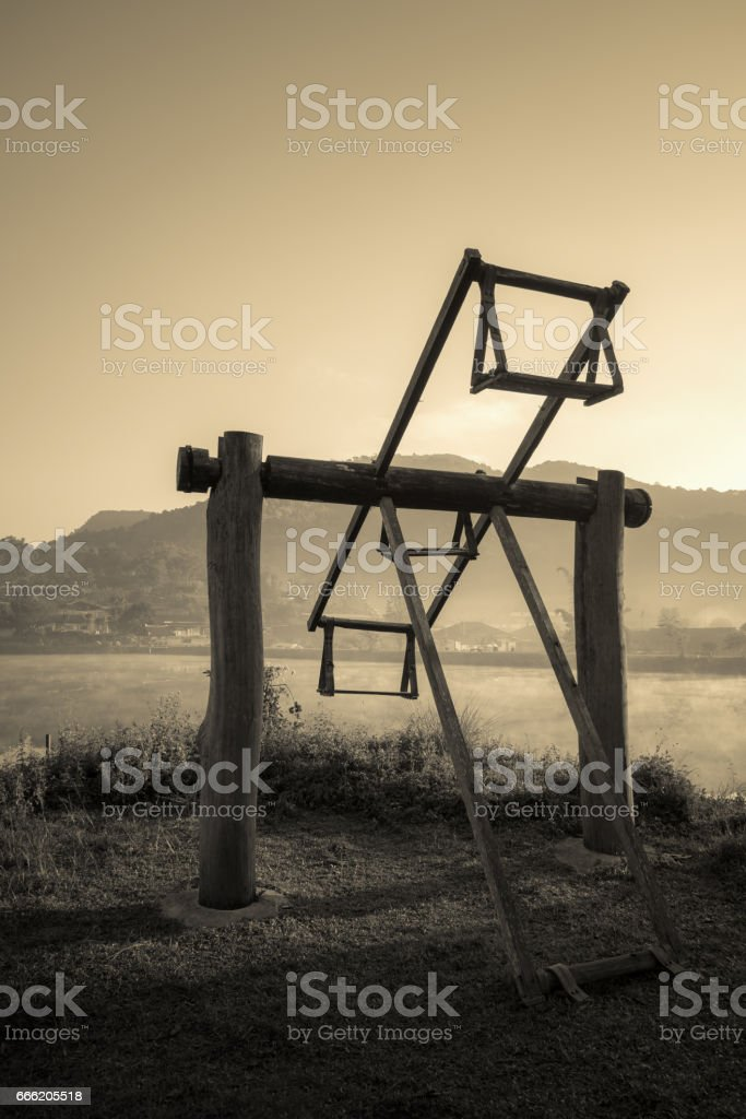 Old wooden totter in the local garden. Filter effect style stock photo