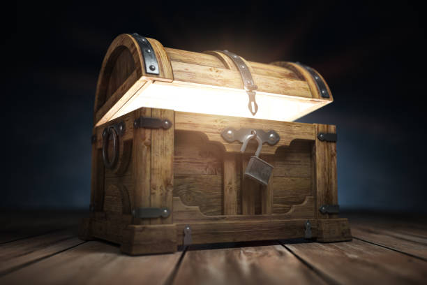 Old wooden treasure chest box with  glow from inside Old wooden treasure chest box with  glow from inside. 3d illustration antiquities stock pictures, royalty-free photos & images