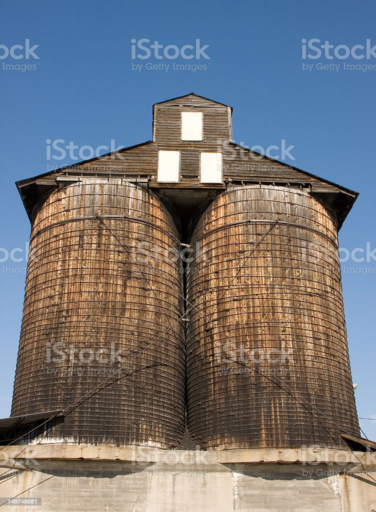 Old Wooden Twin Coal Silos stock photo