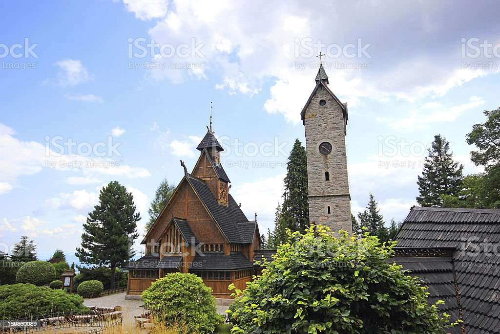 Old wooden Vang stave church with tower of stone stock photo