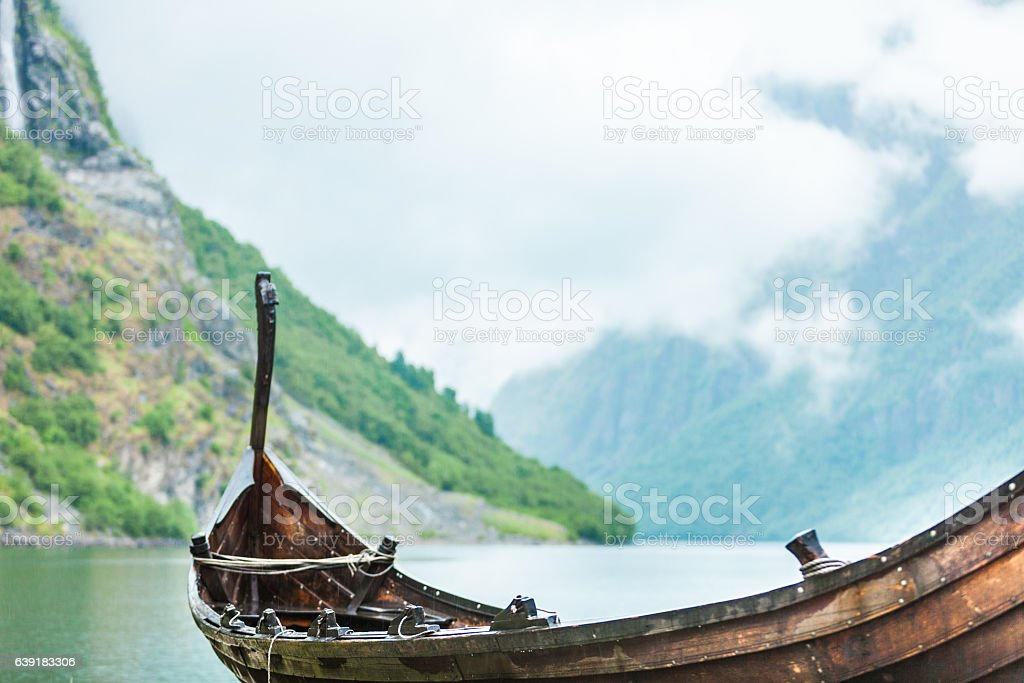 Old wooden viking boat in norwegian nature stock photo