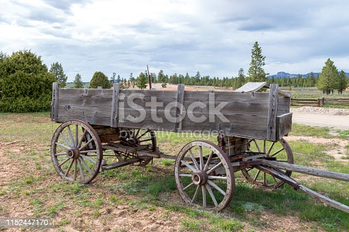 This old time wagon is set in a horse pasture near the highway that runs in front of Bryce Canyon National Park in Utah.