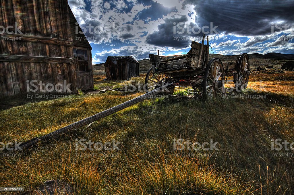 Old wooden wagon in ghost town Bodie, HDR image stock photo