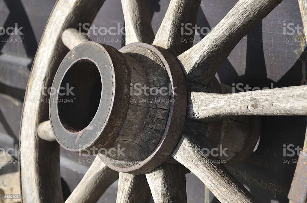Old wooden wagon wheel in ranch. XL size. royalty-free stock photo