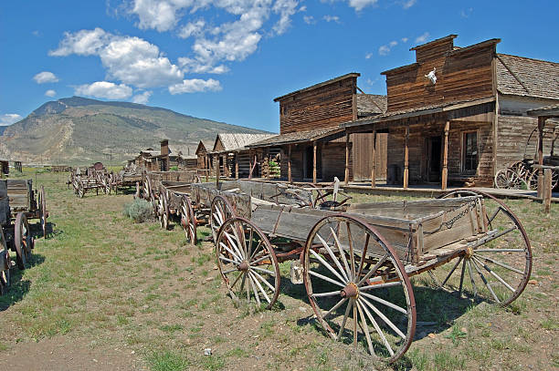 old wooden wagons in a ghost town - western town stock photos and pictures