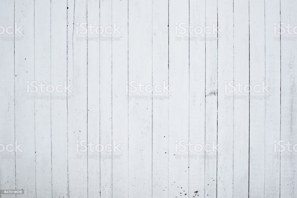 Old wooden wall painted with lime, the back side of the house stock photo
