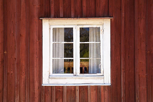 Old wooden wall with window in white frame stock photo