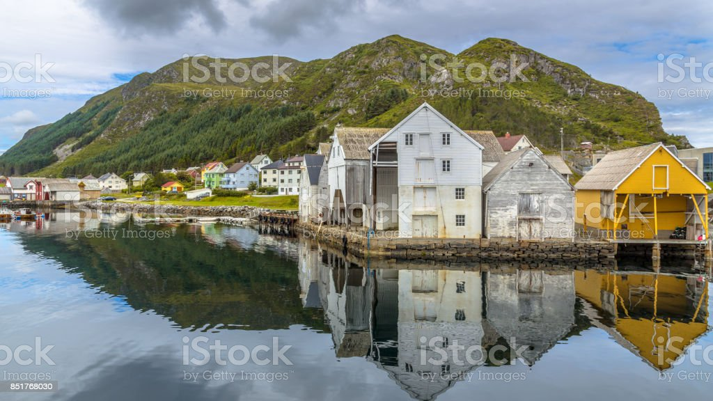 Old wooden Warehouses in the harbour of Runde stock photo