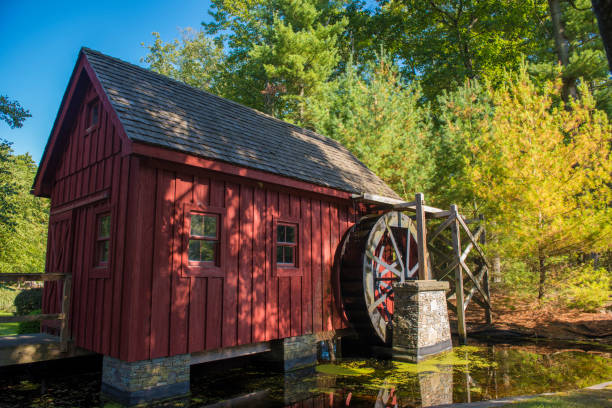 Old Wooden Water Mill by a Pond An old wooden water mill by a pond at Hawley, Pennsylvania babcock state park stock pictures, royalty-free photos & images