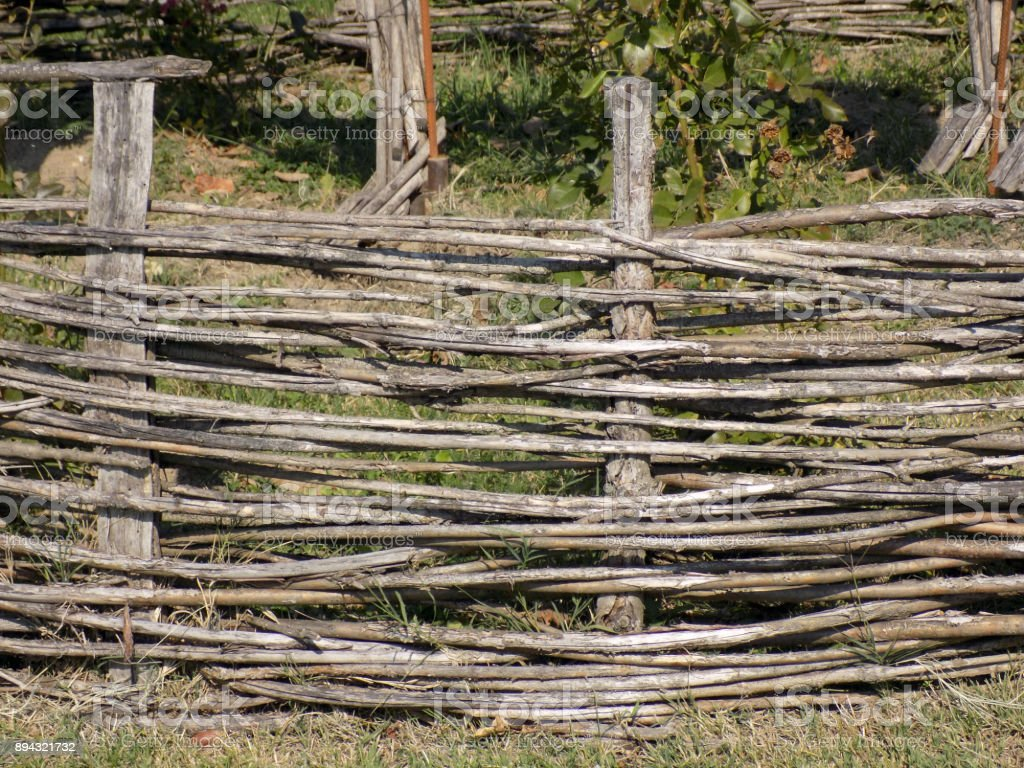 Old Wooden Wattle Fence Around The Herb Garden Or Vegetable Garden  Royalty Free Stock Photo