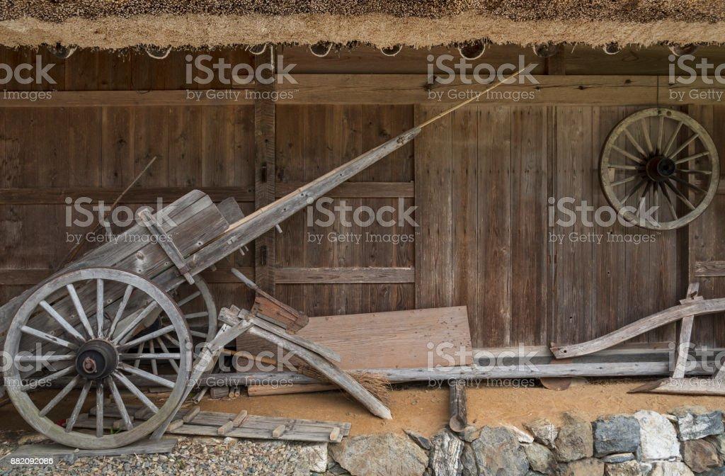 old wooden wheelbarrow in farm house stock photo