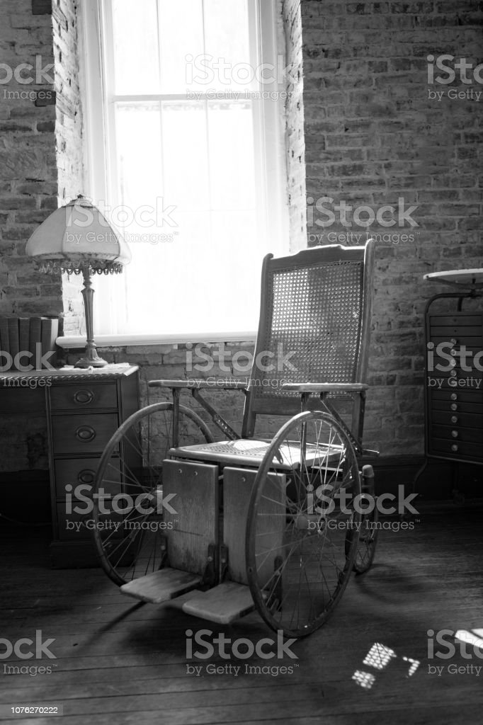 Old wooden wheelchair in black and white. stock photo