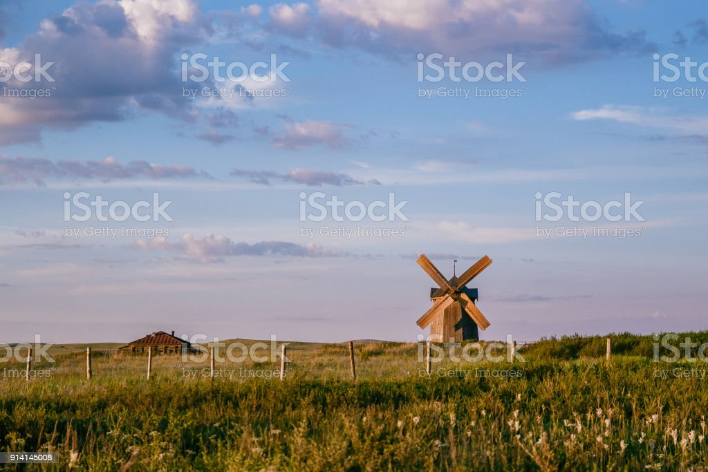 old wooden windmill in a deserted field. Landscape, Arkaim, Russia stock photo