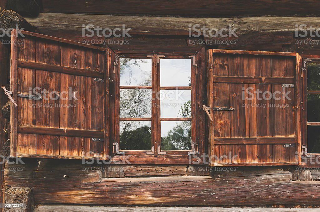 Old wooden window with shutters stock photo