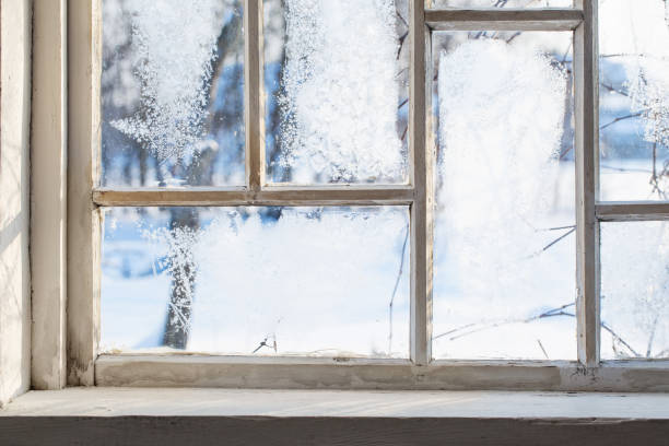 old wooden window with winter frost stock photo